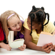 2 young girls reading books together