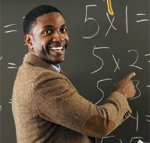 Image of a teacher at a chalk board.