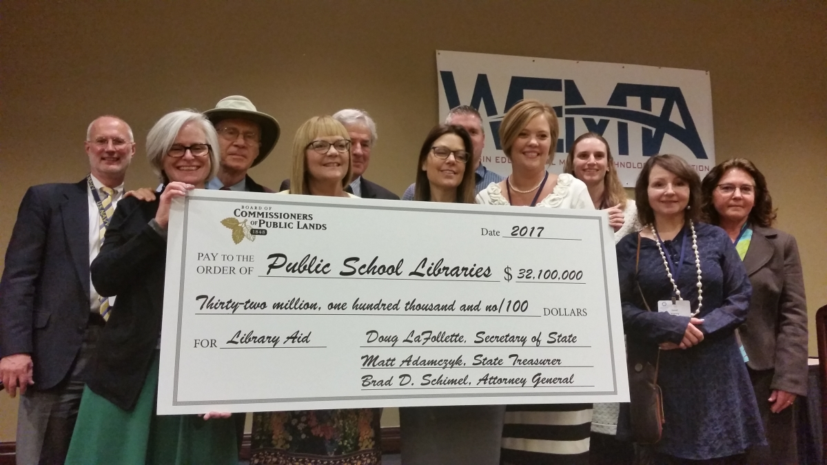 WEMTA Members 2017 holding check to Public School Libraries