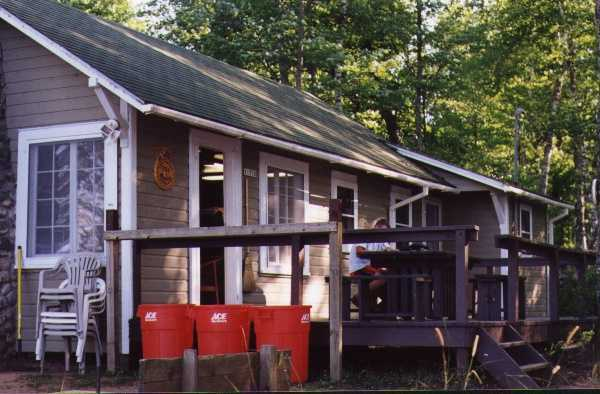 photo exterior side view of cabin with porch