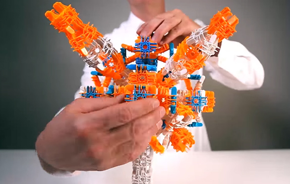 Someone working with intricate construction-type toys