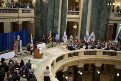 photo of Schools of Recognition ceremony - large crowd at Capitol, State Superintendent Carolyn Stanford Taylor speaking