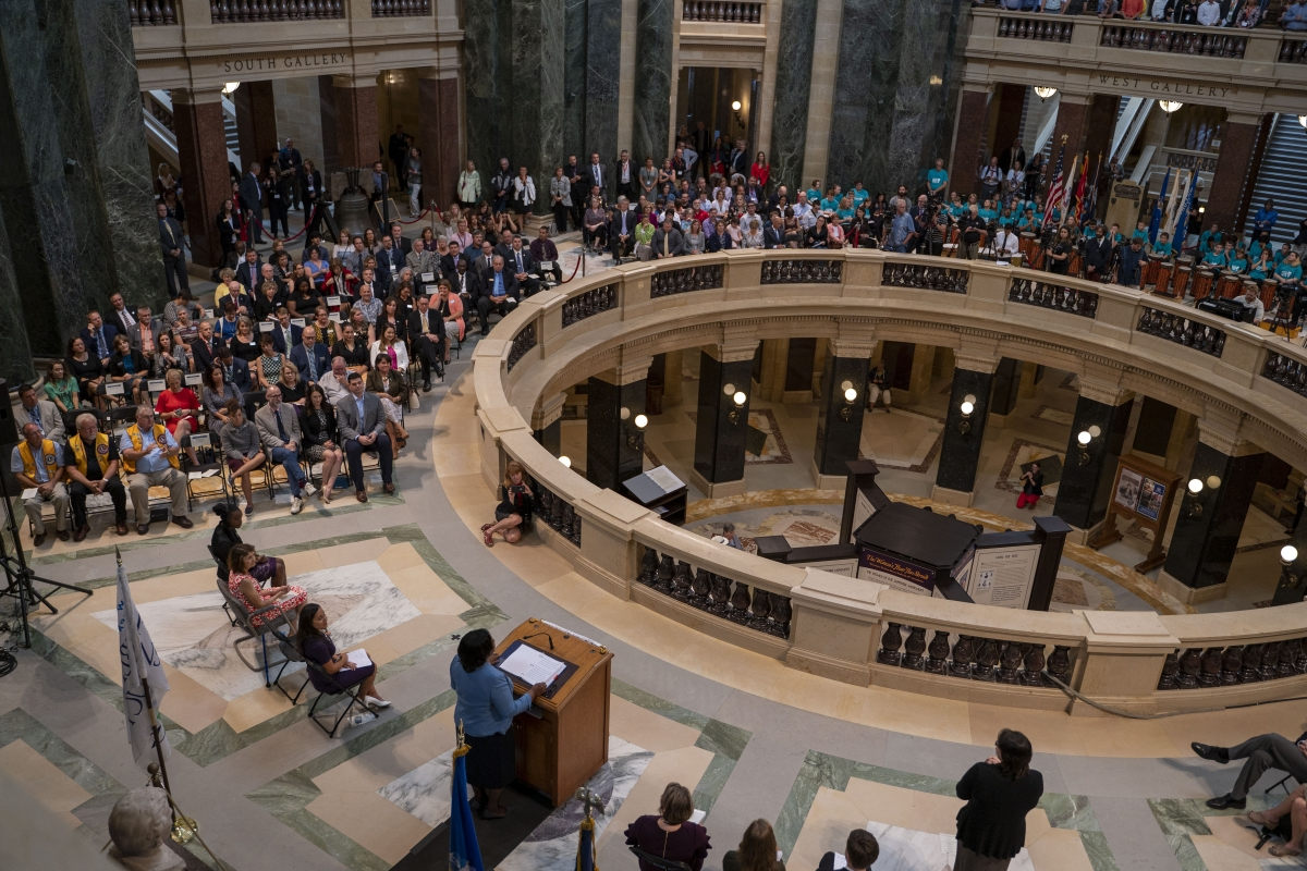 Large crowd listening to State Superintendent Carolyn Stanford Taylor at State of Education Address, State Capitol Rotunda