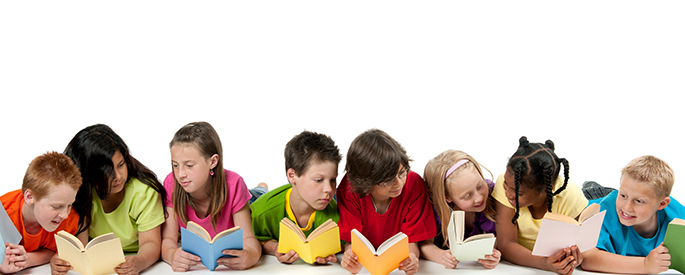 A line of children reading books